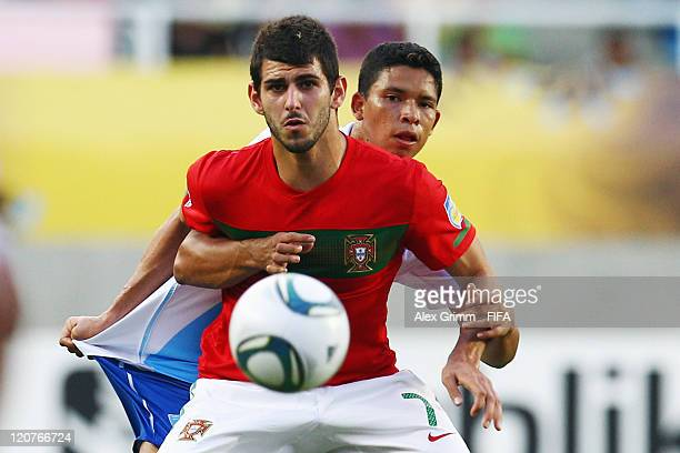 Nelson Oliveira of Portugal is challenged by Manuel Moreno of Guatemala during the FIFA U-20 World Cup 2011 round of 16 match between Portugal and...
