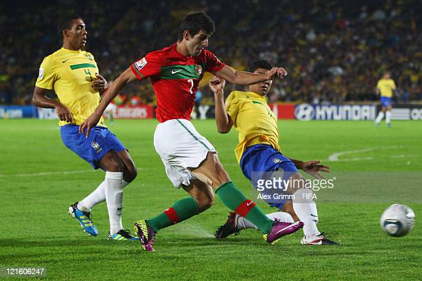 Nelson Oliveira of Portugal scores his team's second goal against Juan and Casemiro of Brazil during the FIFA U20 World Cup 2011 final between Brazil...