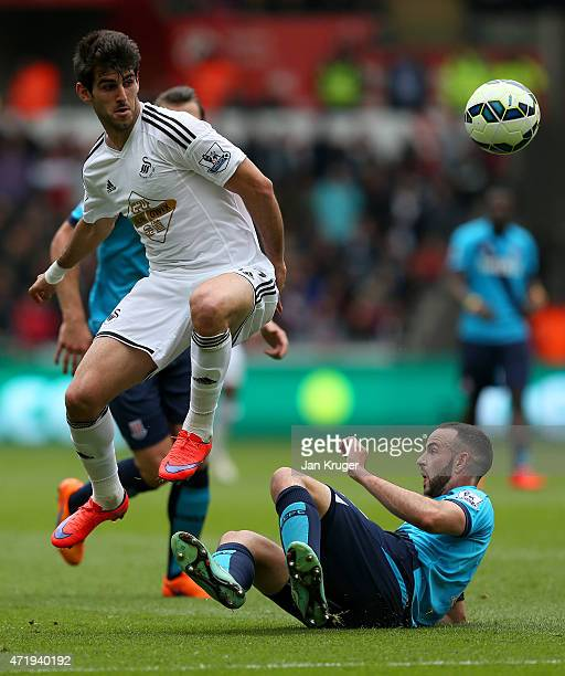 Nelson Oliveira of Swansea City and Phillip Bardsley of Stoke City compete for the ball during the Barclays Premier League match between Swansea City...