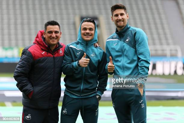 Nelson Oliveira with players Roque Mesa and Federico Fernandez of Swansea City pose for a picture prior to the game during the Premier League match...
