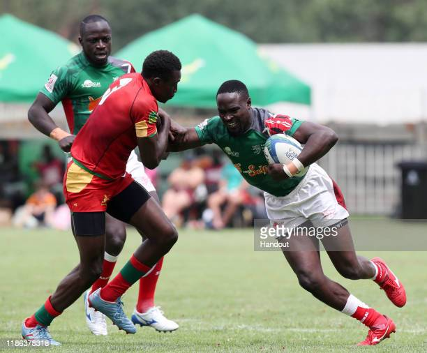 Nelson Oyoo of Kenya challenged by Diaby Ibrahima of Senegal during the 2019 Rugby Africa Mens 7s match between Kenya and Senegal at the Bosman...