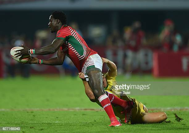 Nelson Oyoo of Kenya is tackled during day two of the Emirates Dubai Rugby Sevens HSBC Sevens World Series match between Australia and Kenya on...