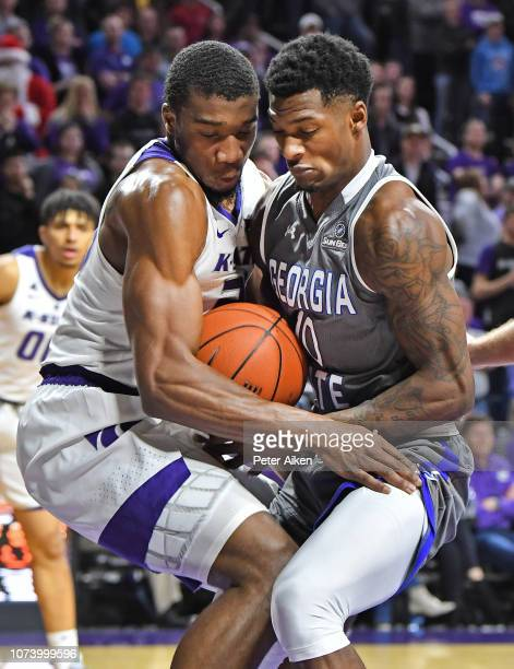 Nelson Phillips of the Georgia State Panthers and Xavier Sneed of the Kansas State Wildcats battle for the ball during the first half on December 15,...
