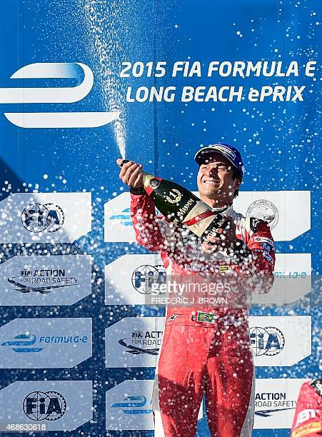 Nelson Piquet Jr. Celebrates with champagne on the podium after winning the inaugural Formula E Long Beach ePrix race in Long Beach, California on...