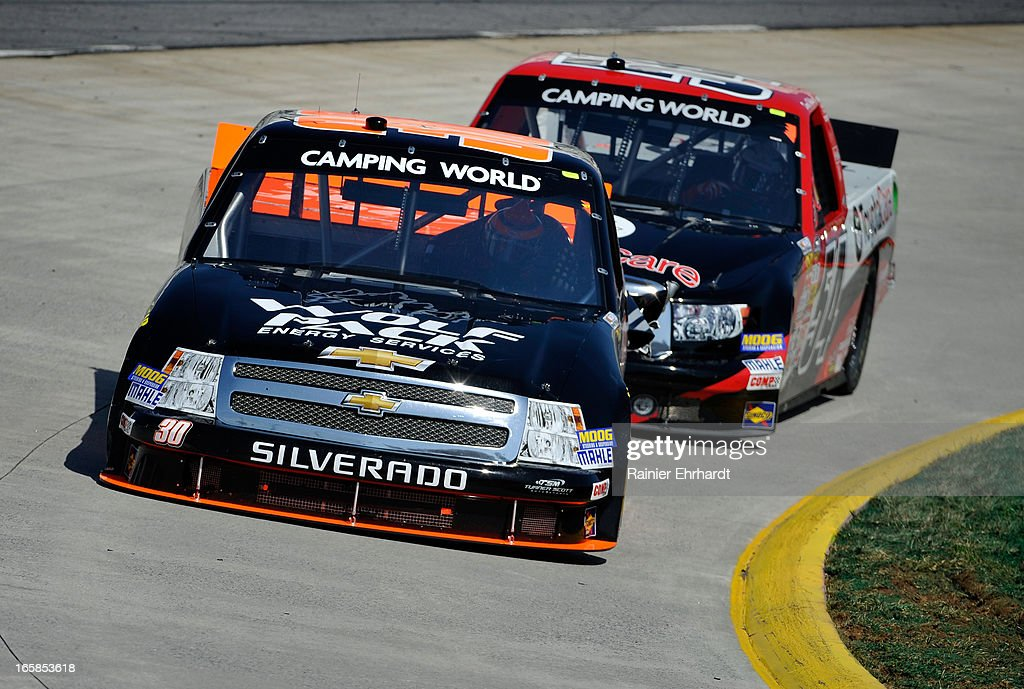 Nelson Piquet Jr Driver Of The Wolfpack Chevrolet Leads Darrell Wallace Jr  Driver Of The Toyota