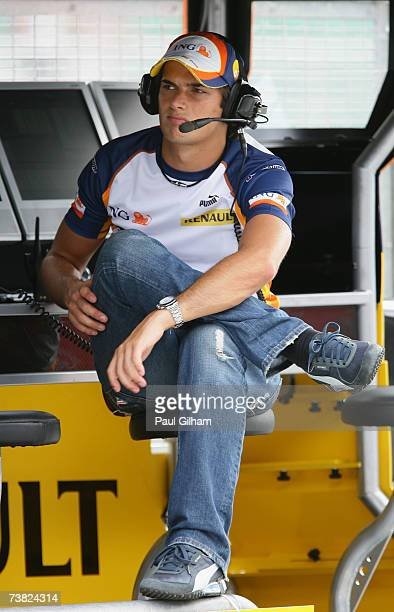 Nelson Piquet Jr of Brazil and Renault looks on from the pit wall during the practice for the Malaysian Formula One Grand Prix at the Sepang Circuit...