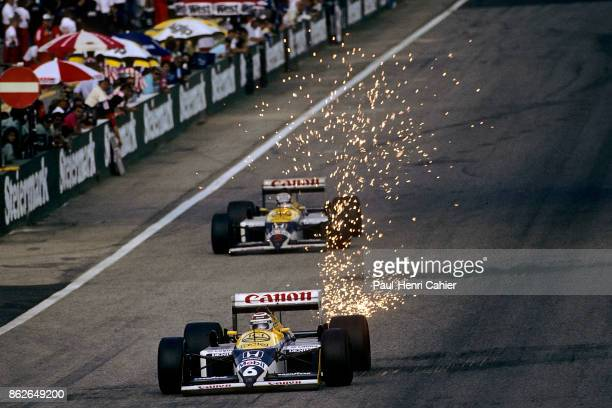 Nelson Piquet Nigel Mansell WilliamsHonda FW11B Grand Prix of Austria Osterreichring 16 August 1987 Nelson Piquet leads WilliamsHonda teammate Nigel...