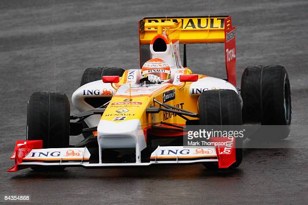 Nelson Piquet of Brazil and Renault drives the new Renault R29 Formula One car at the Autodromo Internacional do Algarve on January 19 2009 in...