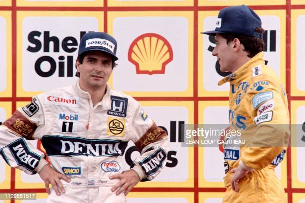 Nelson Piquet of Brazil, second place, and Brazilian Ayrton Senna , third place, stand on the podium on July 12, 1987 after the victory of Nigel...