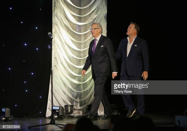Nelson Rising and Christopher Rising walk onstage at the 2017 Make a Wish Gala on November 9 2017 in Los Angeles California