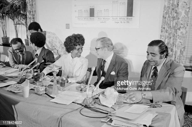 Nelson Rockefeller chats with Rep Shirley Chisholm Rep Charles Rangel and others at the congressional Black Caucus full employment forum