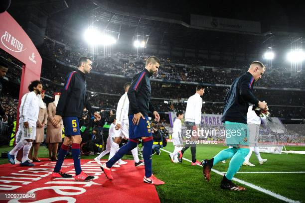 Nelson Semedo, Gerard Pique and Sergio Busquets of FC Barcelona walk onto the pitch during the Liga match between Real Madrid CF and FC Barcelona at...