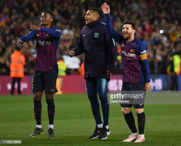 Nelson Semedo, Jason Murillo and Lionel Messi of FC Barcelona celebrate as they win the La Liga following their victory in the La Liga match between...