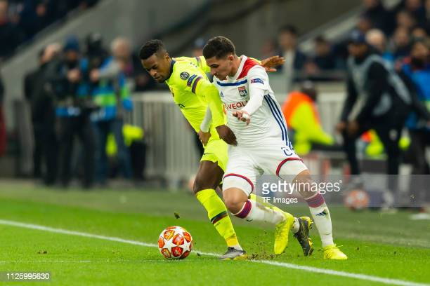 Nelson Semedo of Barcelona and Houssem Aouar of Olympique Lyon battle for the ball during the UEFA Champions League Round of 16 First Leg match...
