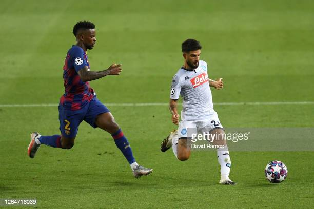 Nelson Semedo of Barcelona battles for possession with Lorenzo Insigne of SSC Napoli during the UEFA Champions League round of 16 second leg match...
