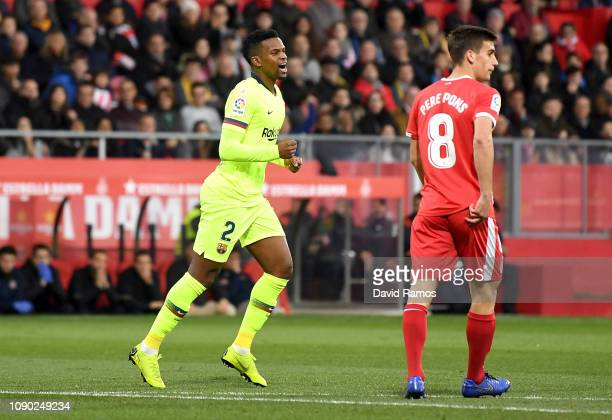 Nelson Semedo of Barcelona celebrates after scoring his team's first goal as Pere Pons of Girona reacts during the La Liga match between Girona FC...