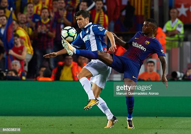 Nelson Semedo of Barcelona competes for the ball with Aaron Martin of Espanyol during the La Liga match between Barcelona and Espanyol at Camp Nou on...