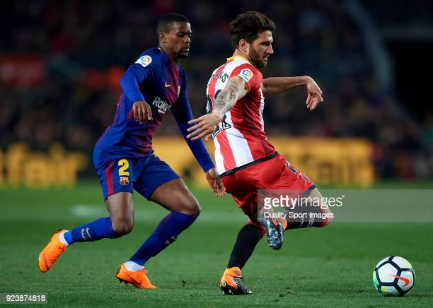 Nelson Semedo of Barcelona competes for the ball with Carles Planas of Girona during the La Liga match between Barcelona and Girona at Camp Nou on...