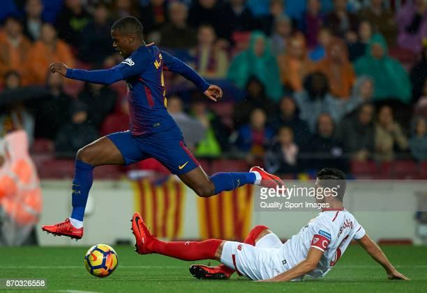 Nelson Semedo of Barcelona competes for the ball with Sergio Escudero of Sevilla during the La Liga match between Barcelona and Sevilla at Camp Nou...