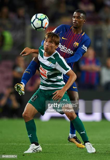 Nelson Semedo of Barcelona competes for the ball with Takashi Inui of Eibar during the La Liga match between Barcelona and Eibar at Camp Nou on...
