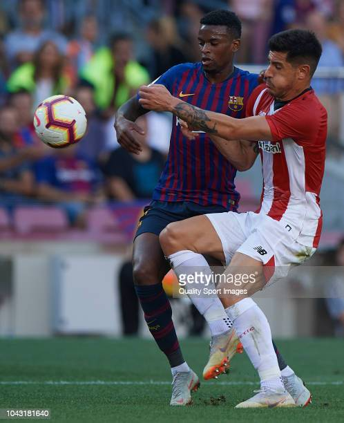 Nelson Semedo of Barcelona competes for the ball with Yuri Berchiche of Athletic Club during the La Liga match between FC Barcelona and Athletic Club...