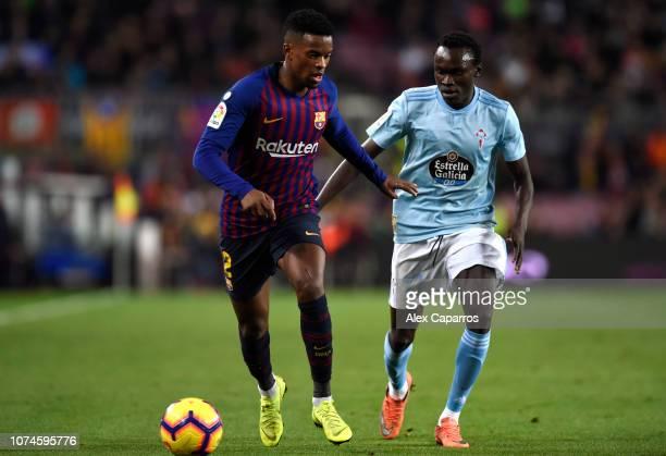 Nelson Semedo of Barcelona is challenged by Pione Sisto of Celta Vigo during the La Liga match between FC Barcelona and RC Celta de Vigo at Camp Nou...