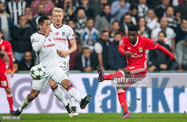 Nelson Semedo of Benfica scores his teams second goal against Adriano of Istanbul during the UEFA Champions League match between Besiktas JK and SL...