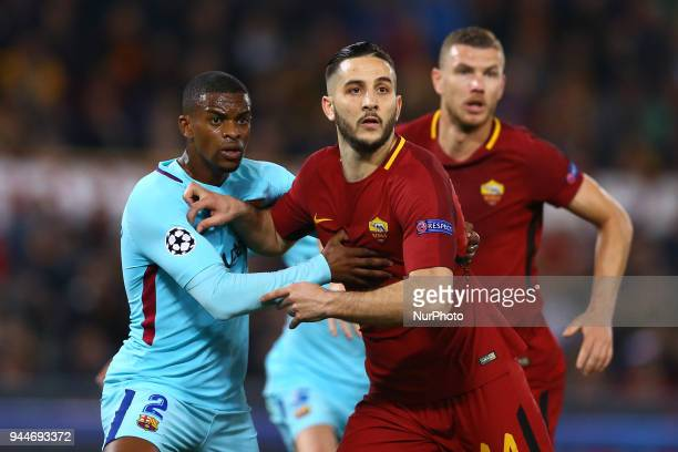 Nelson Semedo of FC Barcelona and Konstantin Manolas of Roma at Olimpico Stadium in Rome Italy on April 10 during UEFA Champions League Quarter Final...
