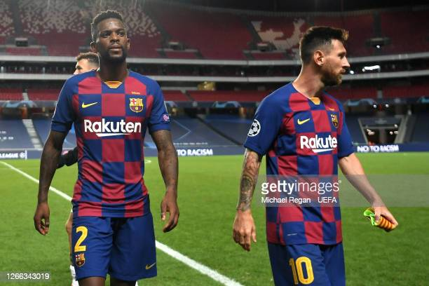 Nelson Semedo of FC Barcelona and Lionel Messi of FC Barcelona look dejected following their team's defeat in the UEFA Champions League Quarter Final...
