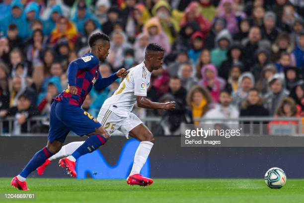 Nelson Semedo of FC Barcelona and Vinicius Jr of Real Madrid battle for the ball during the Liga match between Real Madrid CF and FC Barcelona at...