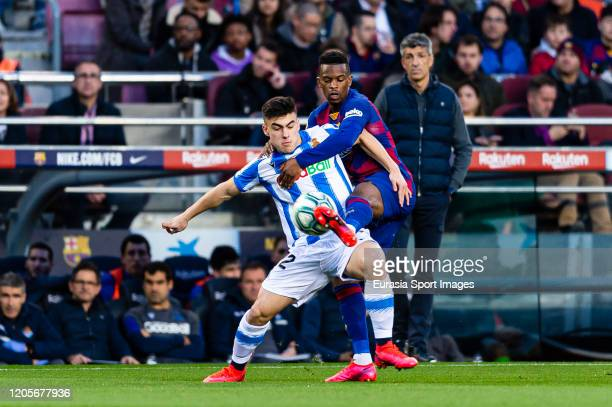 Nelson Semedo of FC Barcelona battles for the ball with Ander Barrenetxea of Real Sociedad during the Liga match between FC Barcelona and Real...