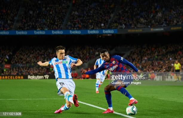 Nelson Semedo of FC Barcelona competes for the ball with Andoni Gorosabel of Real Sociedad during the Liga match between FC Barcelona and Real...