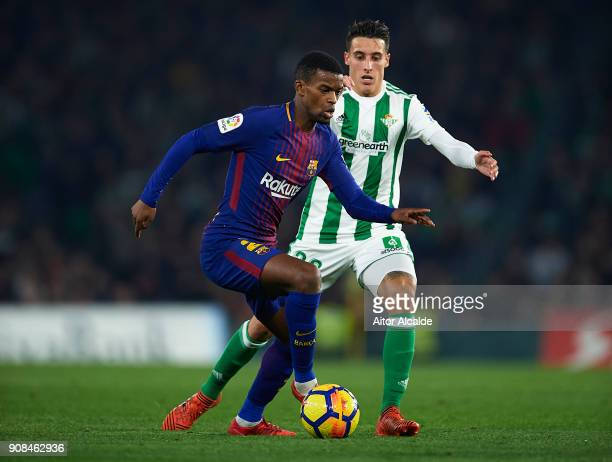 Nelson Semedo of FC Barcelona competes for the ball with Cristian Tello of Real Betis Balompie the La Liga match between Real Betis and Barcelona at...