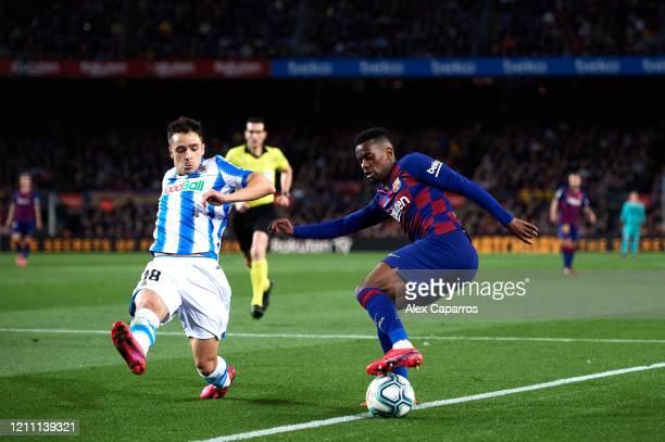 Nelson Semedo of FC Barcelona dribbles Andoni Gorosabel of Real Sociedad during the Liga match between FC Barcelona and Real Sociedad at Camp Nou on...