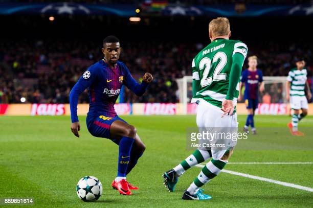 Nelson Semedo of FC Barcelona dribbles Jeremy Mathieu of Sporting CP during the UEFA Champions League group D match between FC Barcelona and Sporting...