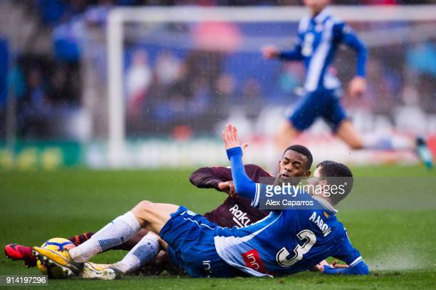 Nelson Semedo of FC Barcelona fights for the ball with Aaron Martin of RCD Espanyol during the La Liga match between Espanyol and Barcelona at RCDE...