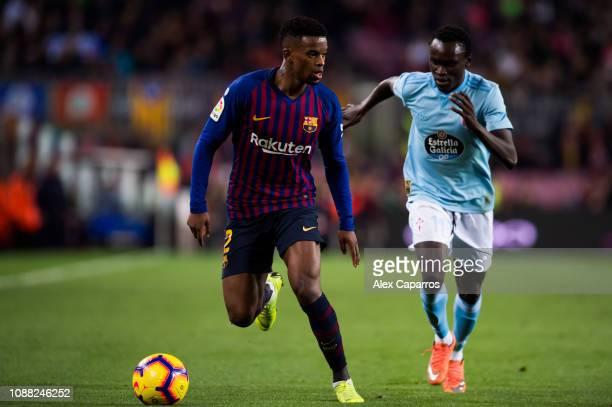 Nelson Semedo of FC Barcelona is challenged by Pione Sisto of RC Celta de Vigo during the La Liga match between FC Barcelona and RC Celta de Vigo at...