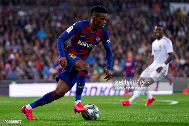 Nelson Semedo of FC Barcelona runs with the ball during the Liga match between Real Madrid CF and FC Barcelona at Estadio Santiago Bernabeu on March...