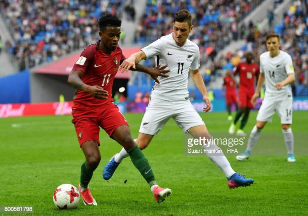 Nelson Semedo of Portugal and Marco Rojas of New Zealan battle for possession during the FIFA Confederations Cup Russia 2017 Group A match between...