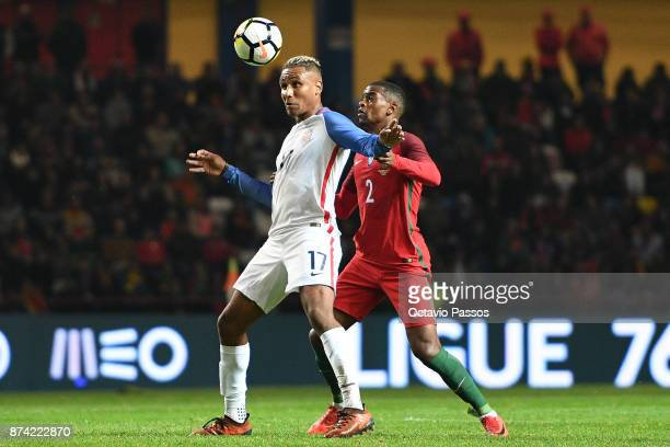 Nelson Semedo of Portugal competes for the ball with Juan Agudelo during the International Friendly match between Portugal and USA at Estadio...