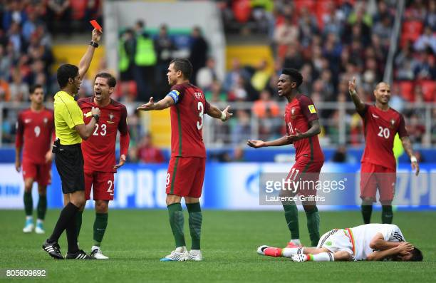 Nelson Semedo of Portugal is shown a red card by Referee Fahad Al Mirdasi during the FIFA Confederations Cup Russia 2017 PlayOff for Third Place...