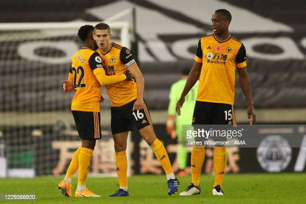 Nelson Semedo of Wolverhampton Wanderers and Conor Coady of Wolverhampton Wanderers at full time during the Premier League match between...