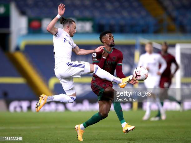 Nelson Semedo of Wolverhampton Wanderers battles for possession with Jack Harrison of Leeds United during the Premier League match between Leeds...