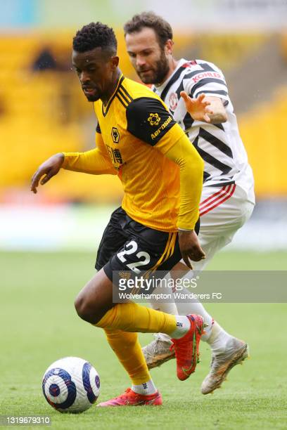 Nelson Semedo of Wolverhampton Wanderers battles for possession with Juan Mata of Manchester United during the Premier League match between...