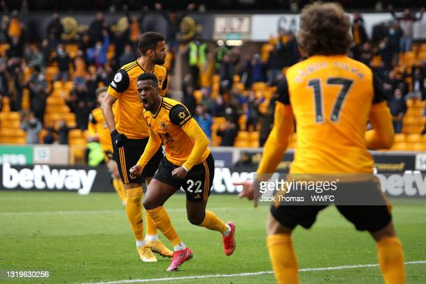 Nelson Semedo of Wolverhampton Wanderers celebrates after scoring their team's first goal with Fabio Silva during the Premier League match between...