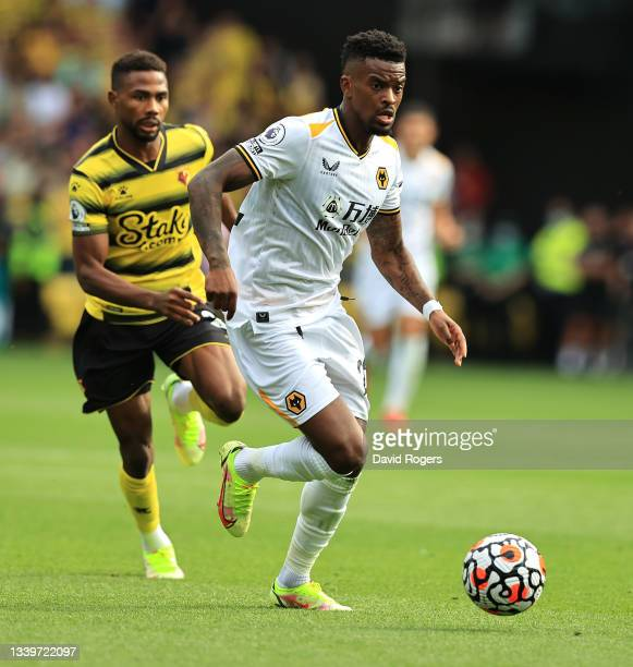 Nelson Semedo of Wolverhampton Wanderers runs with ball during the Premier League match between Watford and Wolverhampton Wanderers at Vicarage Road...