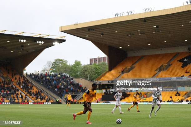 Nelson Semedo of Wolverhampton Wanderers runs with the ball during the Premier League match between Wolverhampton Wanderers and Manchester United at...