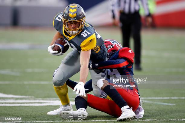 Nelson Spruce of San Diego Fleet is wrapped up by Jeremy Cutrer of Memphis Express during the second half in the Alliance of American Football game...