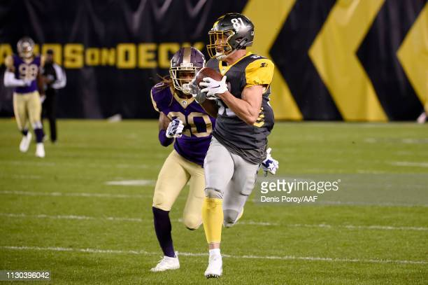 Nelson Spruce of the San Diego Fleet runs with the ball while being chased by Carlos Merritt of the Atlanta Legends in the second quarter during the...