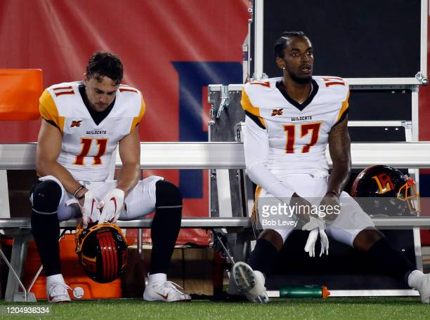 Nelson Spruce of the LA Wildcats and Jalen Greene sit on the bench during the closing moments of the game after losing to the Houston Roughnecks...
